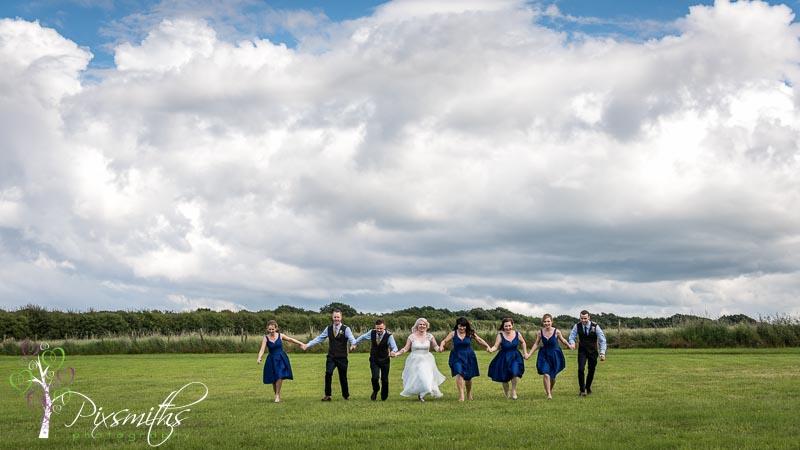 Arrowebrook Wirral Farm wedding bridal party walking shot