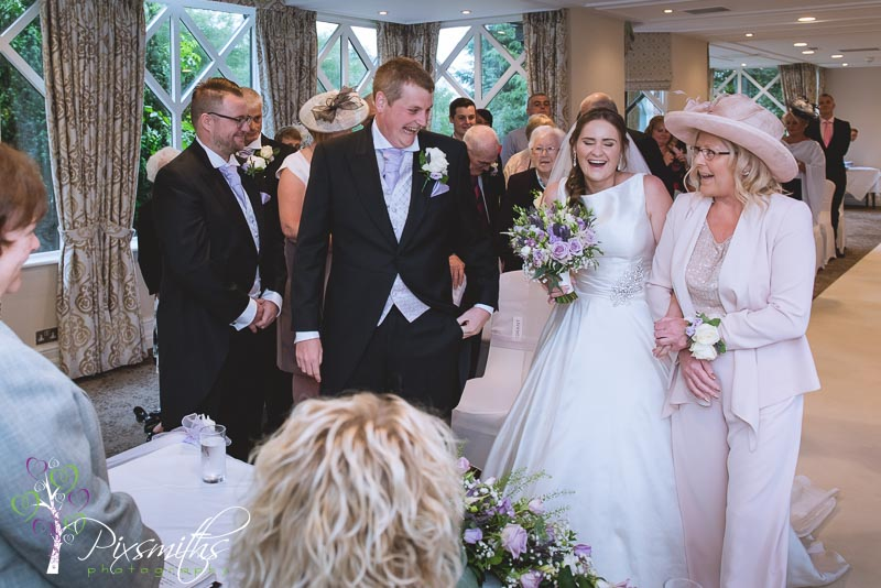 Crabwall Manor wedding photography - bride arrival at ceremony