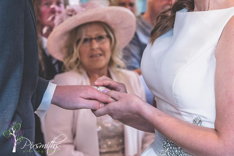 267_Charlton_Crabwall manor wedding photography exchange of rings,