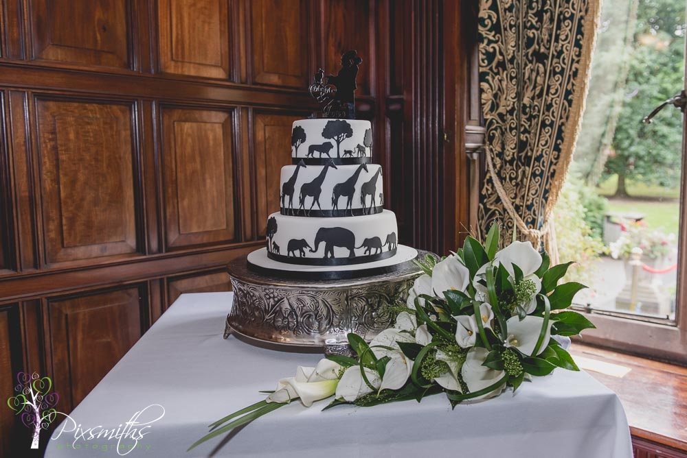 Chester Zoo wedding cake with cute cake topper