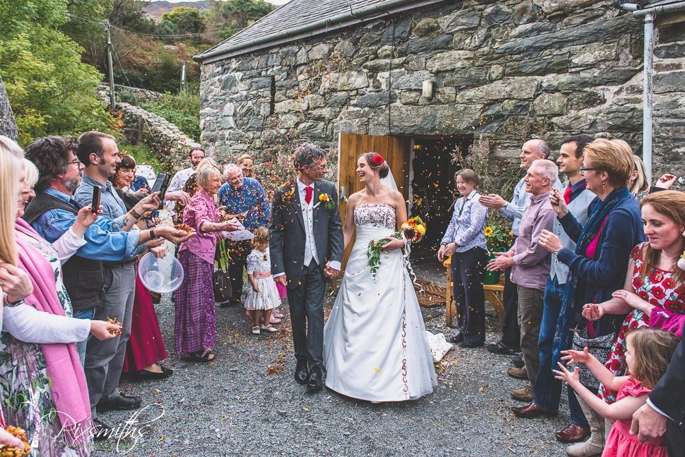happy bride and groom exit from Llyn Gwynant Barn wedding