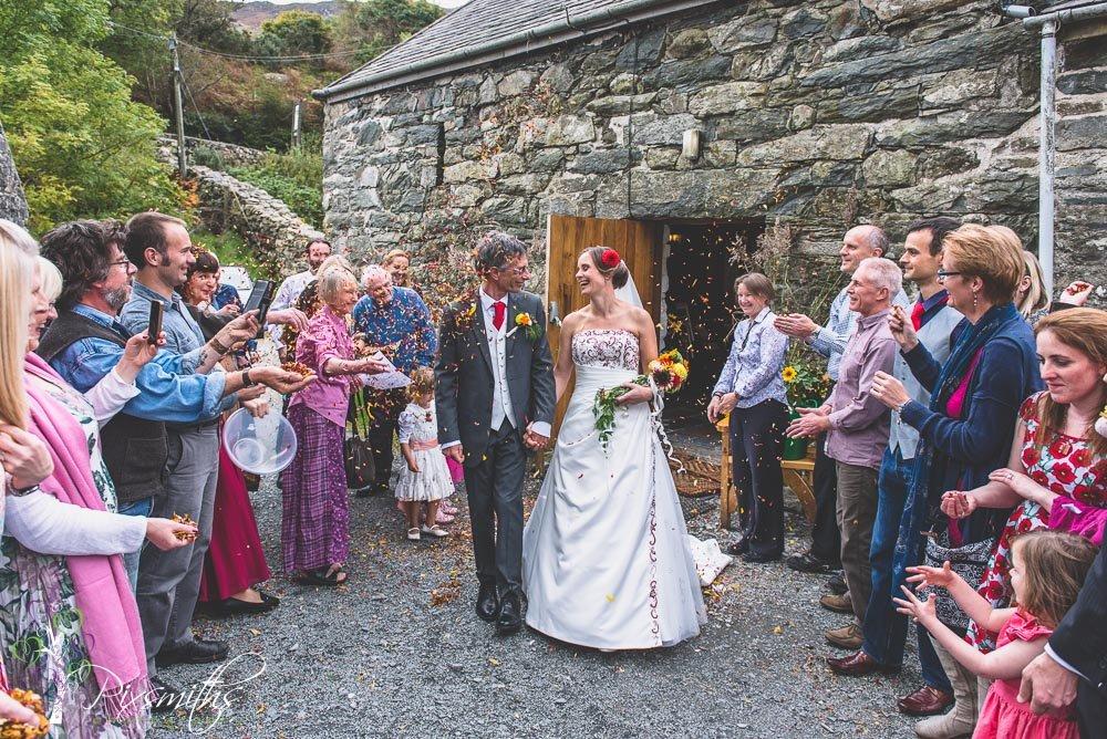 happy bride and groom exit from Llyn Gwynant Barn wedding