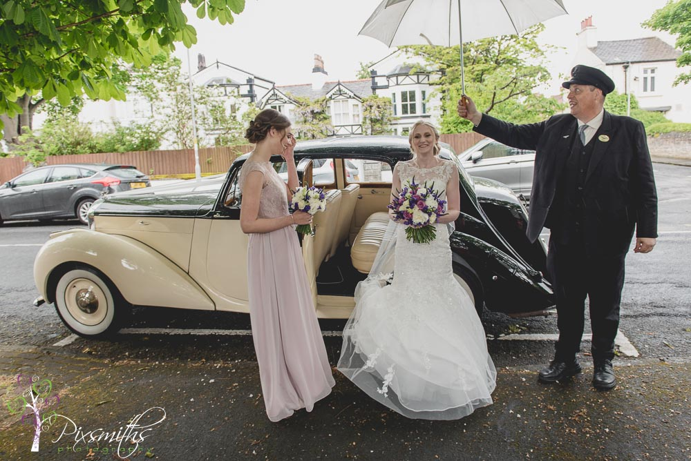 Bride arrival St Hildeburgh's Church Hoylake with Classic Bridal Cars