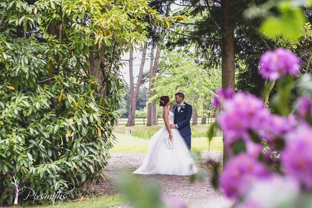 bride and groom portrait Thornton Manor Waterside Marquee