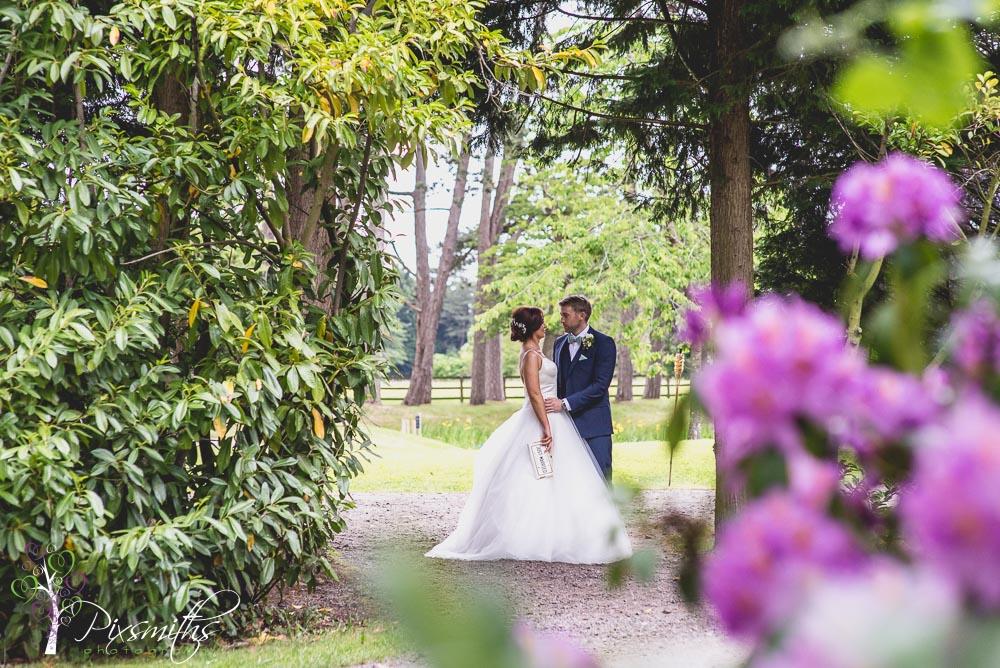 bride and groom portrait Thornton Manor Waterside Marquee