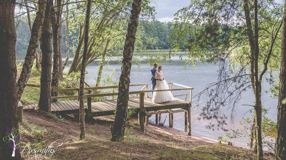 enjoying the lake view Nunsmere Hall wedding photography