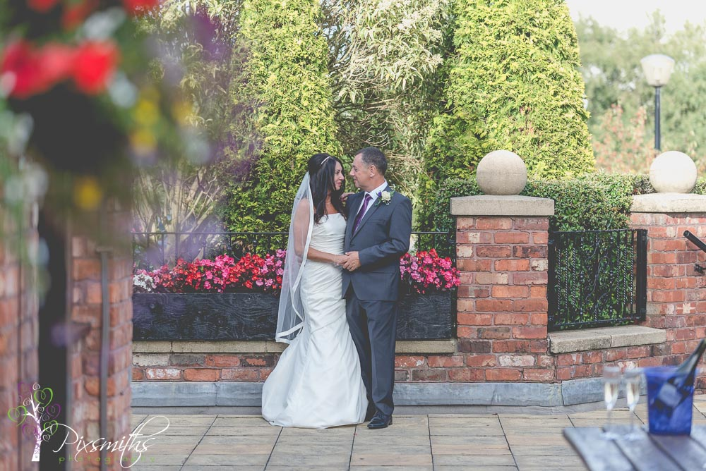 bridal portrait weddign at Village Hotel Bromborough using the pretty flower borders