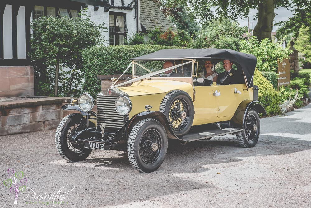Bride and Groom arriving in a yellow Rolls Royce at Inglewood Manor