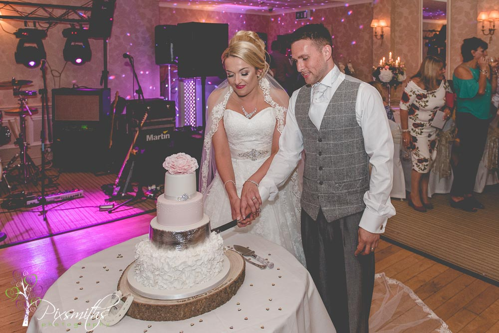 Cake cutting Rowton hall wedding photography