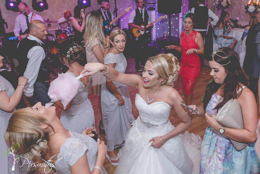 fun with candyfloss on teh dance floor Rowton Hall Wedding
