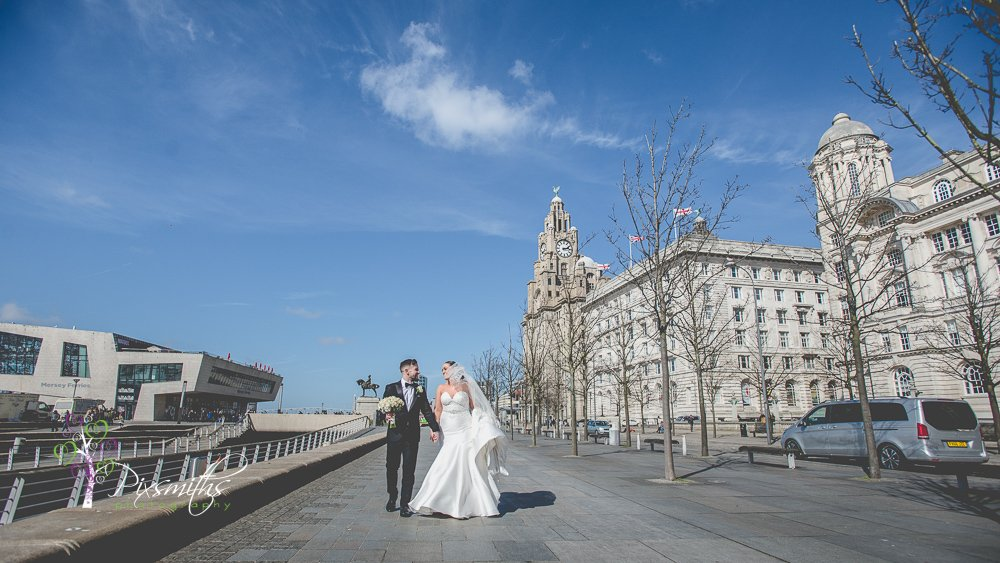 newly weds strolling after Liverpool city centre wedding