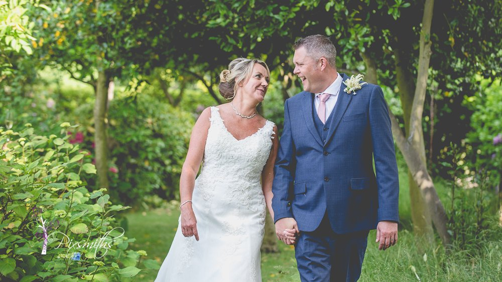 relaxed stroll in garden Mere Brook House Wedding