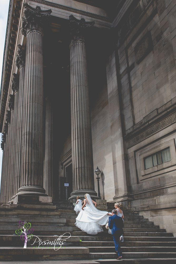 bride walking up steps to enter St George's Hall south side