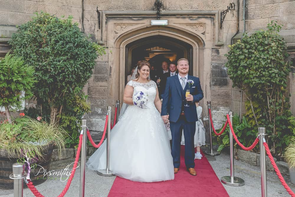 Bride and Groom exit after Leasowe Castle Twilight wedding