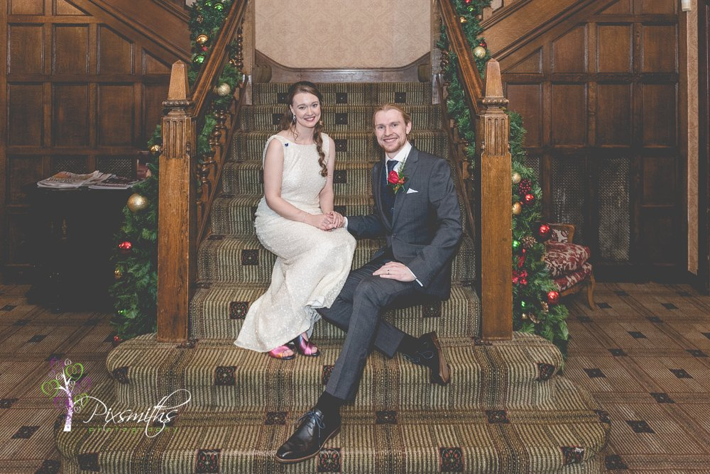 festive stair shot Inglewwod MAnor wedding