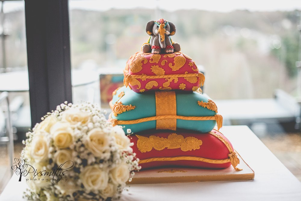 colourful Indian cake with elephant topper Abode Chester wedding reception