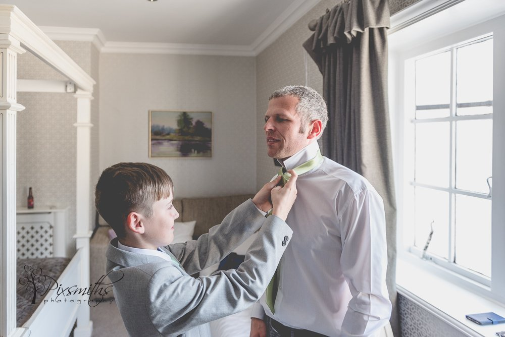 helping hamd from son to Dad on his wedding day at Inglewood Manor
