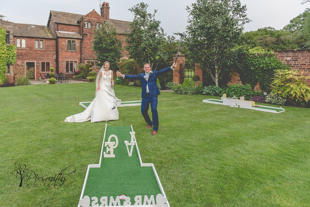 bride and groom enjoying crazy golf at their Colshaw Hall wedding