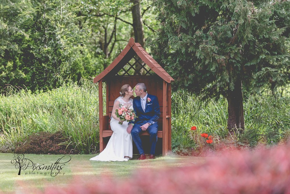 Bride and Groom enjoying the gardens at Crabwall MAnor