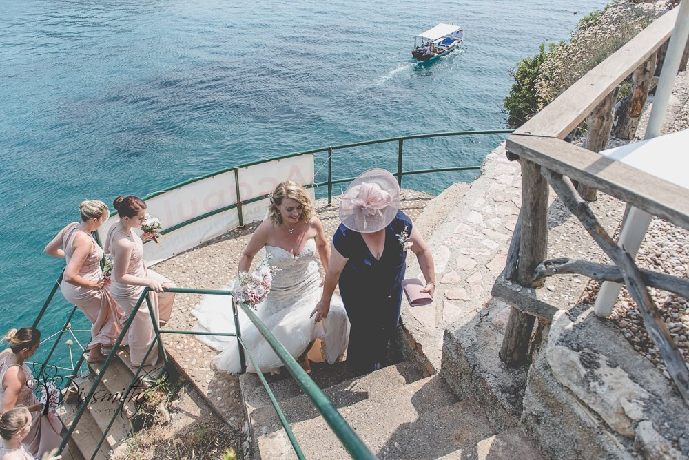 ascending steps to Acapulco Bar Paleokastritsa destination wedding