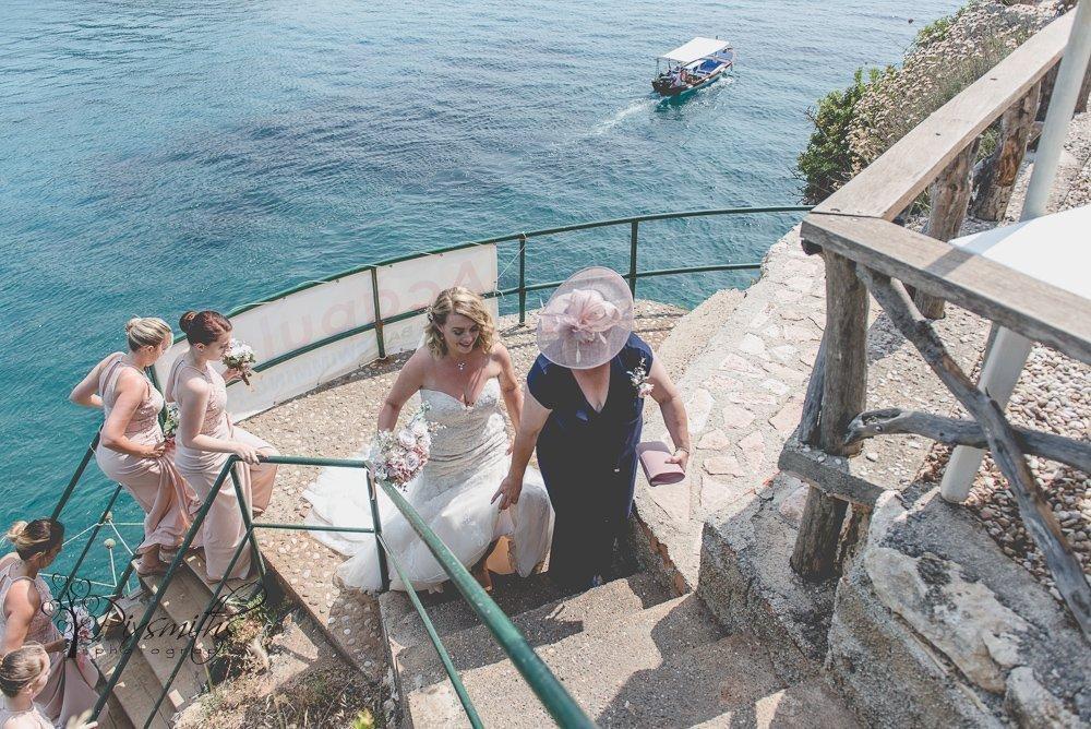 ascending steps to Acapulco Bar Paleokastritsa destination wedding
