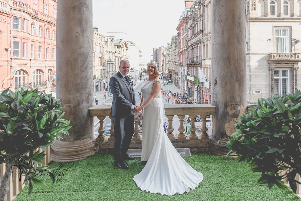 bride and groom portrait on balcony of Liverpool Town Hall