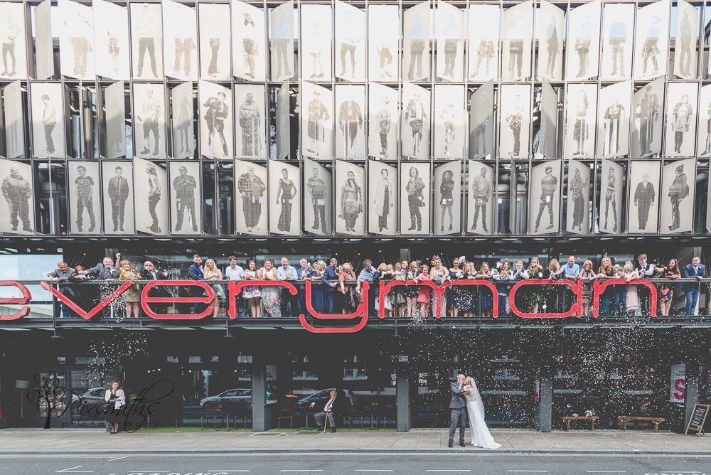 group photo balcony of Everyman Theatre wedding