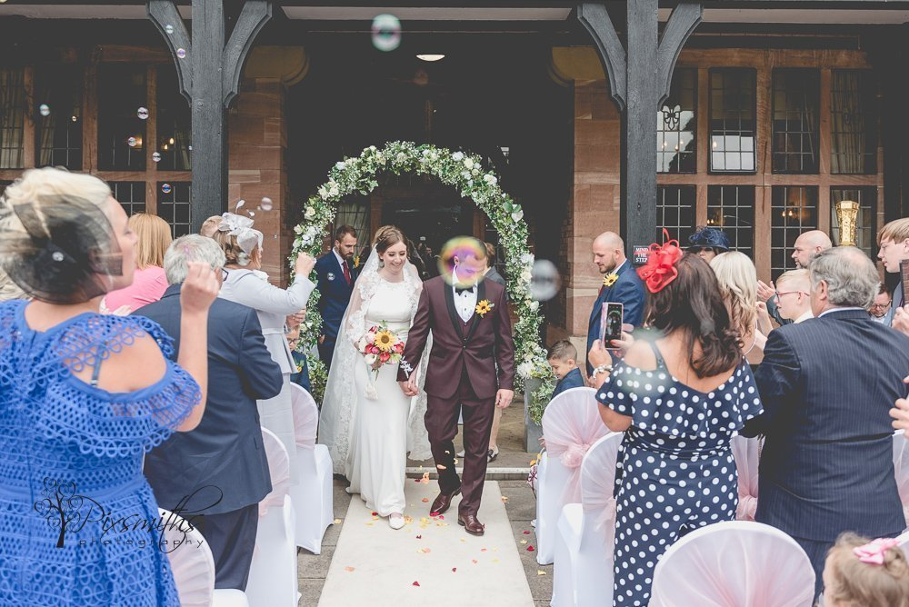 exiting gorgeous Inglewood Manor wedding with bubbles
