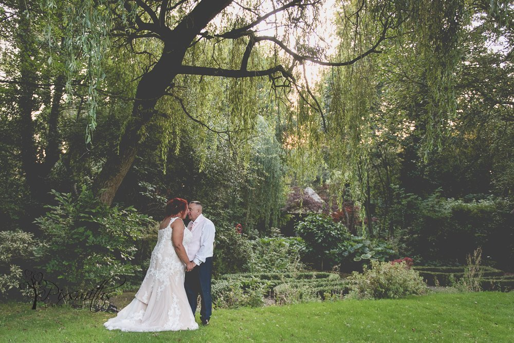 Bride & groom portrait lower garden Brook Hall