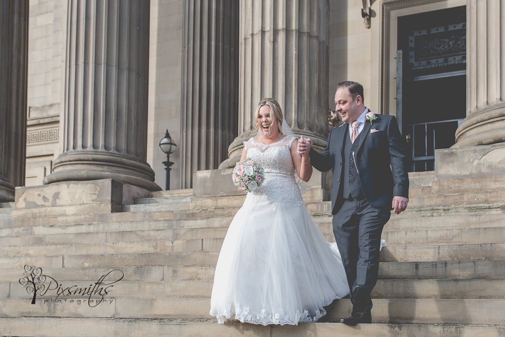 happy bride and groom exiting their intimate Liverpool wedding, St Georges Hall