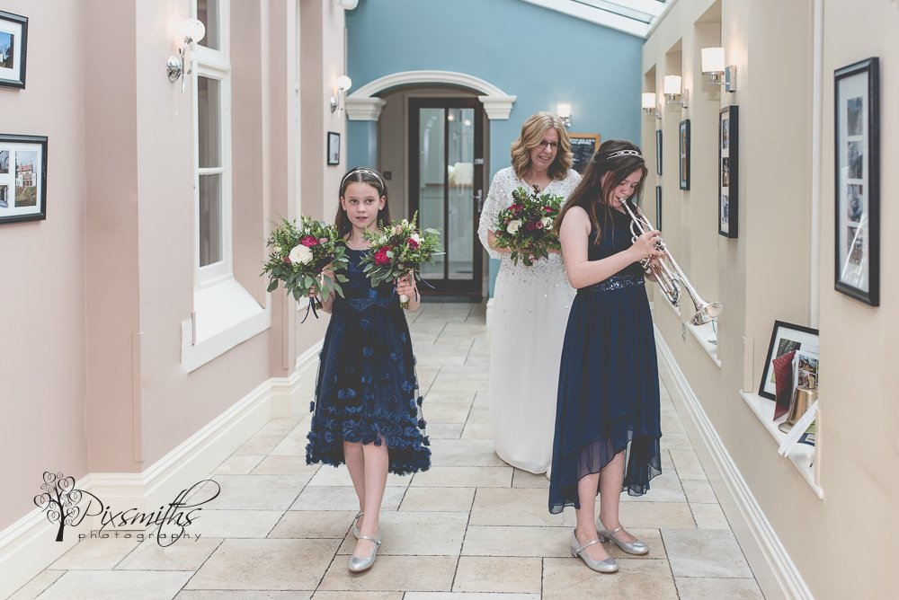 Bride serenades into wedding ceremony Mere Brook House wedding photographer