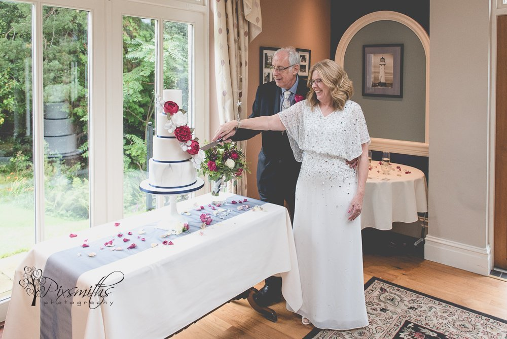 cake cutting Mere Brook House wedding reception