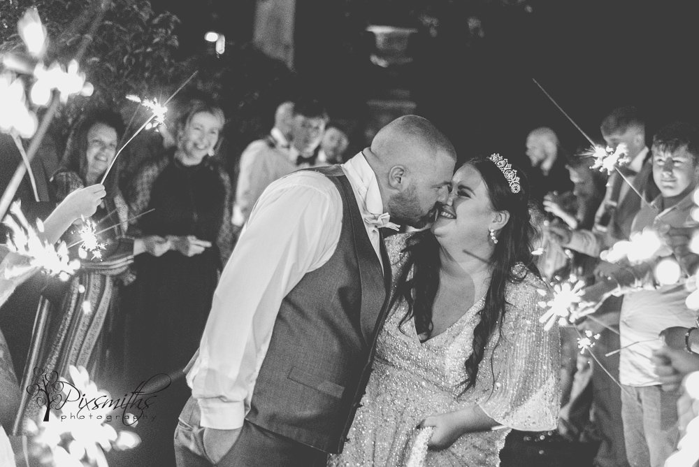 smiling sparkly end to a Doubletree Hilton Chester Hotel wedding