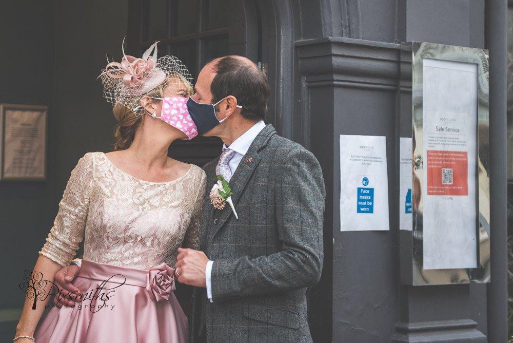 masked bride and groom outside Oddfellows Chester